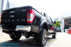 """Rear right view of a Ford PXII Ranger in Black after fitment of a Superior 2"""" Inch Remote Reservoir Lift Kit + Airbag Man Leaf Air Kit"""