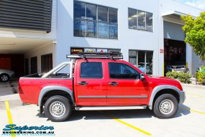 Right side view of a Red Holden RA9 Rodeo before fitment of a Ironman 4x4 Black Commercial Bullbar