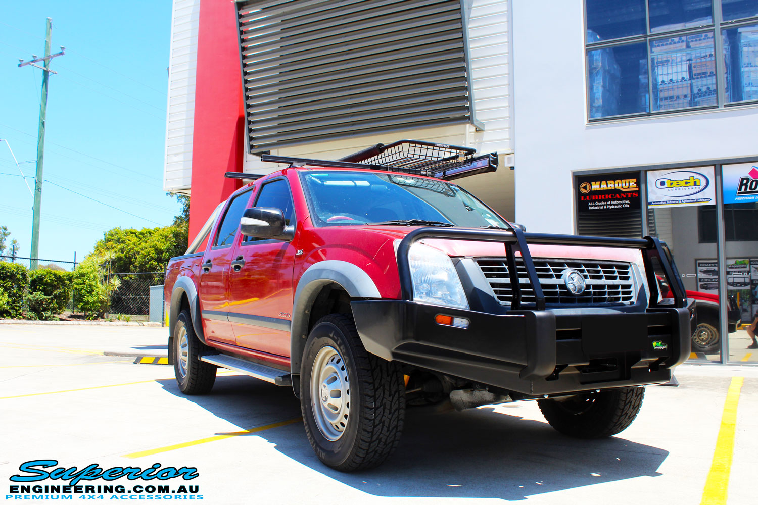 Right front side view of a Red Holden RA9 Rodeo after fitment of a Ironman 4x4 Black Commercial Bullbar