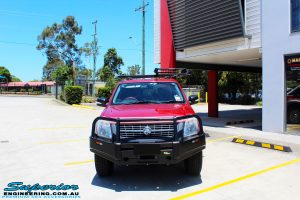 Front on bonnet view of a Red Holden RA9 Rodeo after fitment of a Ironman 4x4 Black Commercial Bullbar