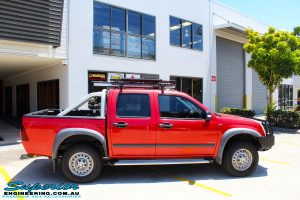 Right side view of a Red Holden RA9 Rodeo after fitment of a Ironman 4x4 Black Commercial Bullbar
