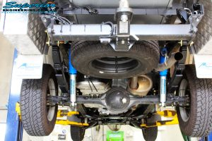 "Rear underbody view of the fitted Superior Nitro Gas 2"" Shocks + Leaf Springs & U-Bolt Kit"