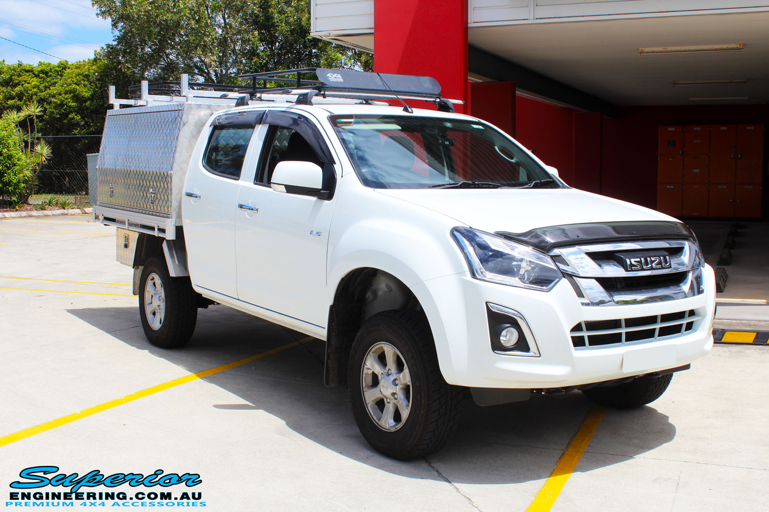 "Right front view of a White Isuzu D-Max Dual Cab after fitment of a Superior Nitro Gas 2"" Inch Lift Kit"