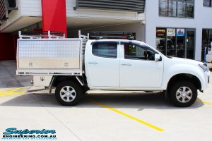 "Right side view of a White Isuzu D-Max Dual Cab after fitment of a Superior Nitro Gas 2"" Inch Lift Kit"