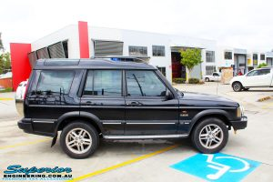 Right side view of a Black Landrover Discovery 2 before fitment of a Tough Dog 35mm Lift Kit