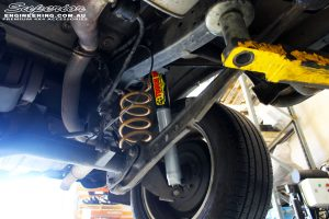 Rear left underbody view of the fitted Tough Dog Shock + Coil Spring