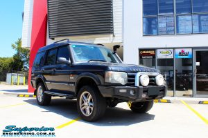 Right front side view of a Black Landrover Discovery 2 after fitment of a Tough Dog 35mm Lift Kit