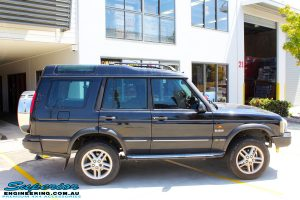 Right side view of a Black Landrover Discovery 2 after fitment of a Tough Dog 35mm Lift Kit