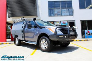 Right front side view of a Mazda BT50 Single Cab in Grey before fitment of New Superior Nitro Gas Front Struts and EFS Coil Springs