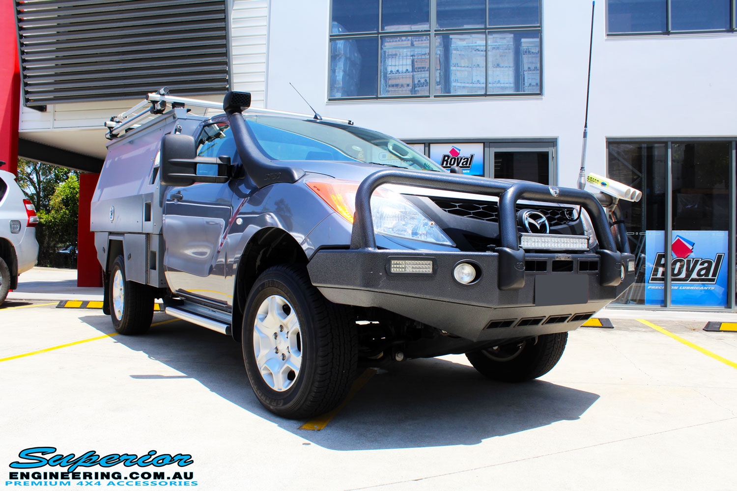 Right front side view of a Mazda BT50 Single Cab in Grey after fitment of New Superior Nitro Gas Front Struts and EFS Coil Springs