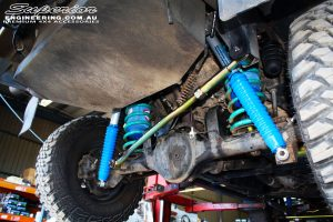 """Rear underbody shot looking at the fitted Superior 4"""" Adjustable Shocks, Adjustable Panhard Rod, Coil Springs & Airbag Man Coil Air Kit"""
