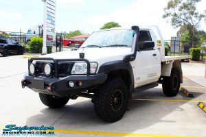 """Front left side view of a White Nissan GU Patrol Ute before fitting the Superior 4"""" Inch Remote Reservoir Hyperflex Kit"""