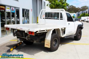 """Rear right side view of a White Nissan GU Patrol Ute before fitting the Superior 4"""" Inch Remote Reservoir Hyperflex Kit"""