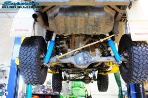 Rear underbody shot of the fitted Panhard Rod, Remote Reservoir Shocks and Coil Springs