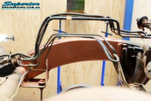 Rear left chassis view being prepped for the Coil Tower Brace Kit and Rear Replacement Coil Tower