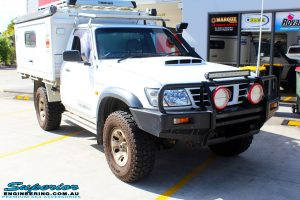 Right front side view of a White Nissan GU Patrol before fitment of a range of Superior and various other brands suspension components