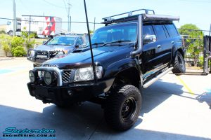 """Front left side view of a Black Nissan GU Patrol Wagon showing its max front right flex before fitting the Superior 2"""" Inch Remote Reservoir Hyperflex Kit with Front & Rear Superflex Sway Bar Kits, Comp Spec 4340m Tie Rod, Long Arms and Coil Tower Brace Kit"""