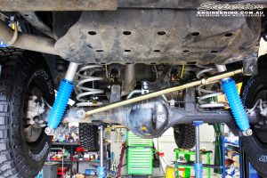 Rear mid underbody view of the fitted Superior Remote Reservoir Shocks, Coil Springs, Rear Panhard Rod & Upper Control Arms
