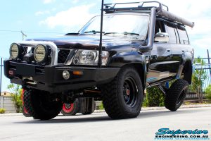 """Close up front left view of a Black Nissan GU Patrol Wagon being flexed after fitting the Superior 2"""" Inch Remote Reservoir Hyperflex Kit with Front & Rear Superflex Sway Bar Kits, Comp Spec 4340m Tie Rod, Long Arms and Coil Tower Brace Kit"""