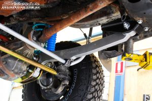 Front right underbody view of the fitted Superior Hyperflex Radius Arm with Tie Rod, Superflex Sway Bar Kit and Remote Reservoir Shock