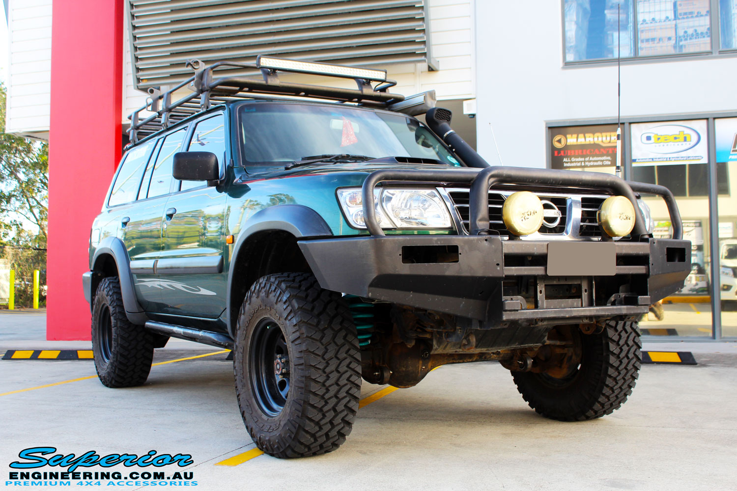 Right front side view of a Green Nissan GU Patrol before fitment of a range of Superior and various other brands suspension components