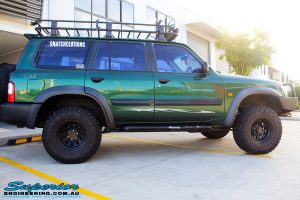 Right side view of a Green Nissan GU Patrol before fitment of a range of Superior and various other brands suspension components
