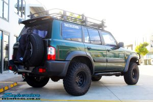 Rear right view of a Green Nissan GU Patrol before fitment of a range of Superior and various other brands suspension components