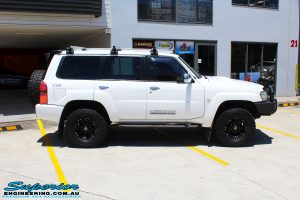 "Right side view of a Nissan GU Patrol Wagon before fitment of a Superior Remote Reservoir 2"" Inch Lift Kit"