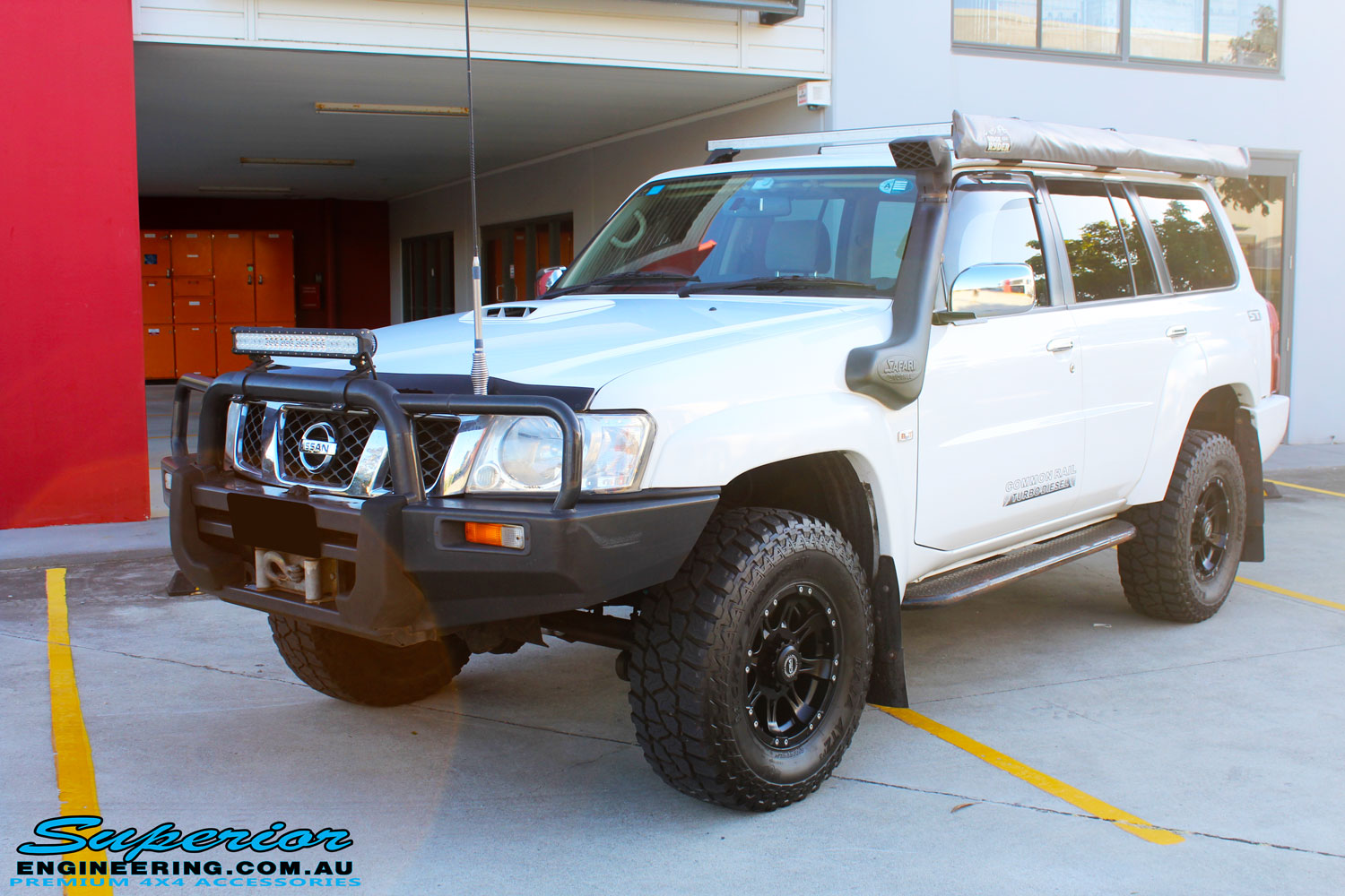 """Front left side view of the Nissan GU Patrol Wagon after fitment of a Superior Remote Reservoir 2"""" Inch Lift Kit"""