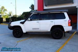 """Left side view of a Nissan GU Patrol Wagon after fitment of a Superior Remote Reservoir 2"""" Inch Lift Kit"""