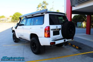 """Rear left side view of a Nissan GU Patrol Wagon after fitment of a Superior Remote Reservoir 2"""" Inch Lift Kit"""