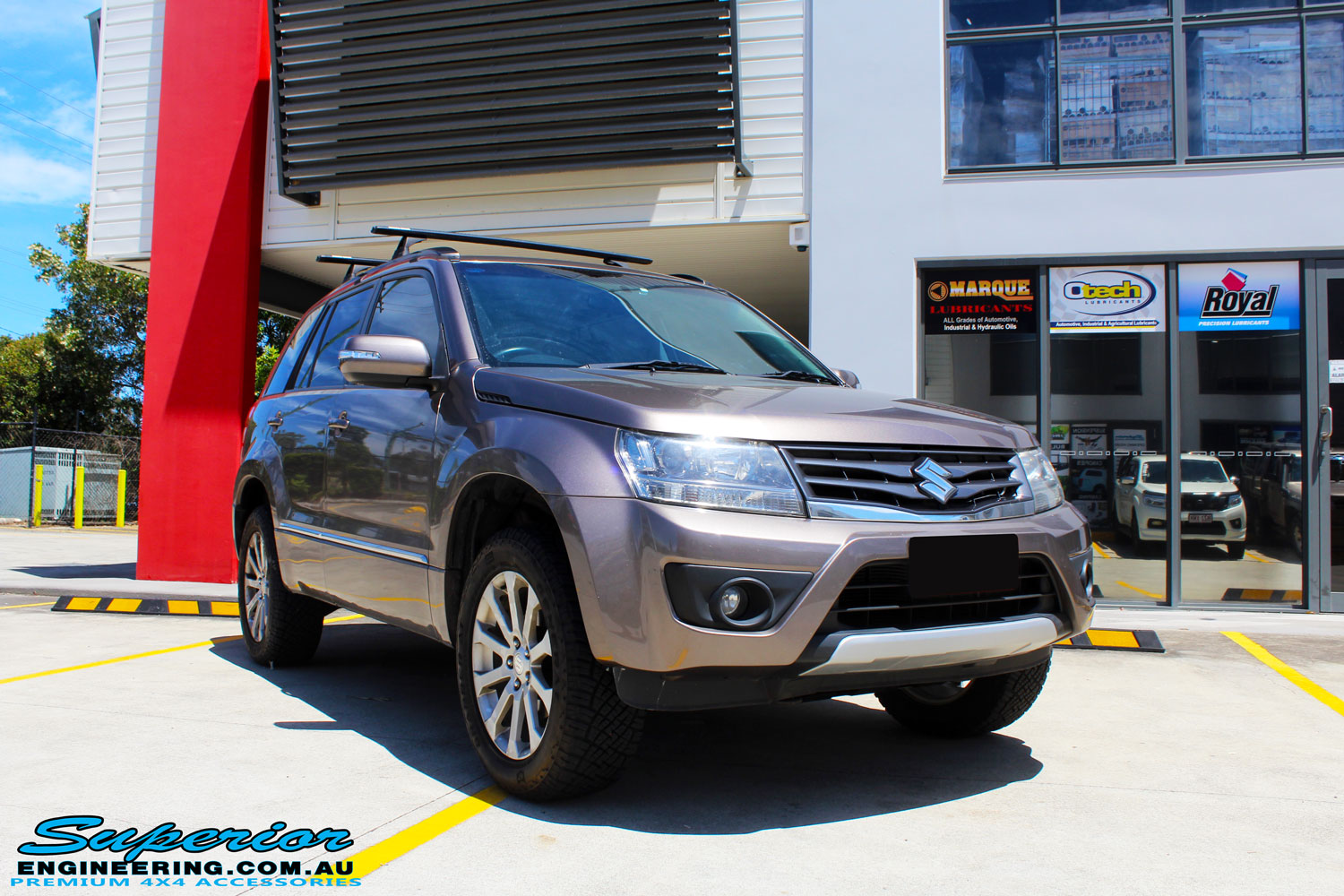 Right front side view of a Suzuki Grand Vitara in Gold after fitment of a Ironman 4x4 45mm Suspension Lift Kit