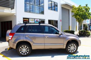 Right side view of a Suzuki Grand Vitara in Gold after fitment of a Ironman 4x4 45mm Suspension Lift Kit