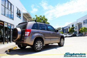 Rear right front side view of a Suzuki Grand Vitara in Gold after fitment of a Ironman 4x4 45mm Suspension Lift Kit
