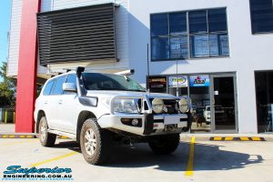 """Right front side view of a Silver Toyota 200 Series Landcruiser before fitment of a Superior Remote Reservoir 2"""" Inch Lift Kit"""
