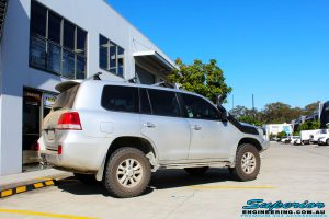 """Rear right side view of a Silver Toyota 200 Series Landcruiser before fitment of a Superior Remote Reservoir 2"""" Inch Lift Kit"""