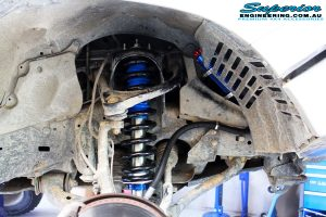 Front right inside guard view of the fitted Superior Remote Reservoir Strut & Coil Spring