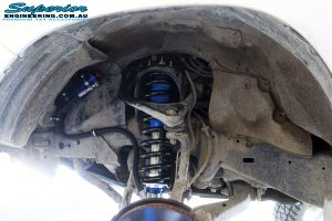 Front left inside guard view of the fitted Superior Remote Reservoir Strut & Coil Spring