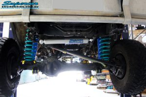 """Front underbody view of the fitted Superior Steering Damper, Adjustable Panhard Rod, Hyperflex Radius Arms, 5"""" Inch Adjustable Monotube Remote Reservoir Shocks + Coil Springs"""