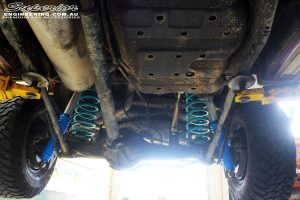 """Mid left underbody view looking back on the fitted 5"""" Inch Adjustable Monotube Remote Reservoir Shocks, Upper Control Arms + Coil Springs"""
