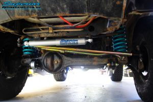 Front underbody view of the fitted Superior Steering Damper, Comp Spec Tie Rod, Panhard Rod, Superflex Radius Arms & Coil Springs