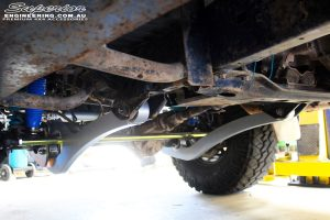 Middle underbody view looking forward of the fitted Superior Superflex Radius Arms, Comp Spec Tie Rod, Remote Reservoir Shocks & Coil Springs