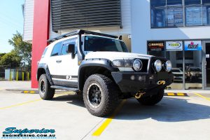 Right front side view of a White Toyota FJ Cruiser before fitment of Superior Chromoly Upper Control Arms