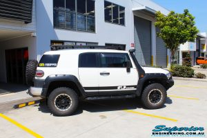 Right side on view of a White Toyota FJ Cruiser after fitment of Superior Chromoly Upper Control Arms