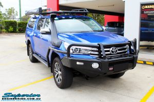 Right front side view of a Blue Toyota Revo Hilux Dual Cab before fitment of a EFS 40mm Lift Kit and Wheel/Tyre Package