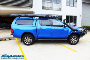 Right side view of a Blue Toyota Revo Hilux Dual Cab before fitment of a EFS 40mm Lift Kit and Wheel/Tyre Package