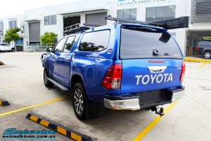 Rear left view of a Blue Toyota Revo Hilux Dual Cab before fitment of a EFS 40mm Lift Kit and Wheel/Tyre Package