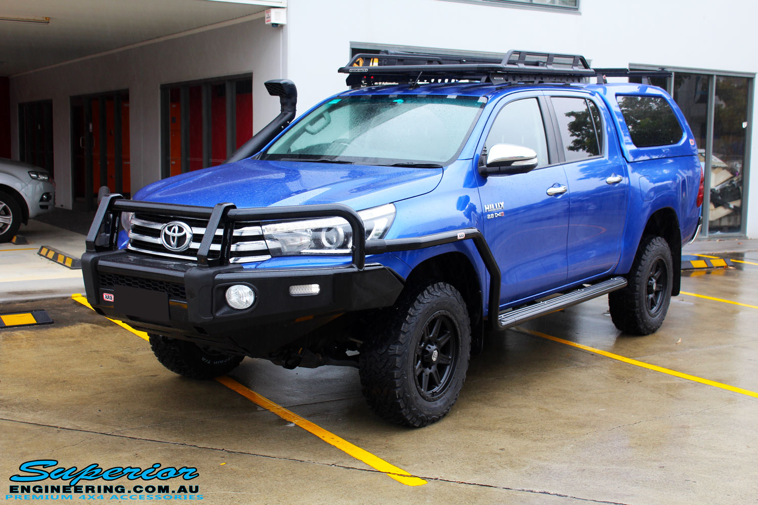 Left front side view of a Blue Toyota Revo Hilux Dual Cab after fitment of a EFS 40mm Lift Kit and Wheel/Tyre Package