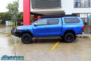 Left side view of a Blue Toyota Revo Hilux Dual Cab after fitment of a EFS 40mm Lift Kit and Wheel/Tyre Package