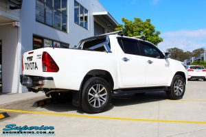 "Rear right view of a White Toyota Revo Hilux Dual Cab before fitment of a Bilstein 2"" Inch Lift Kit"